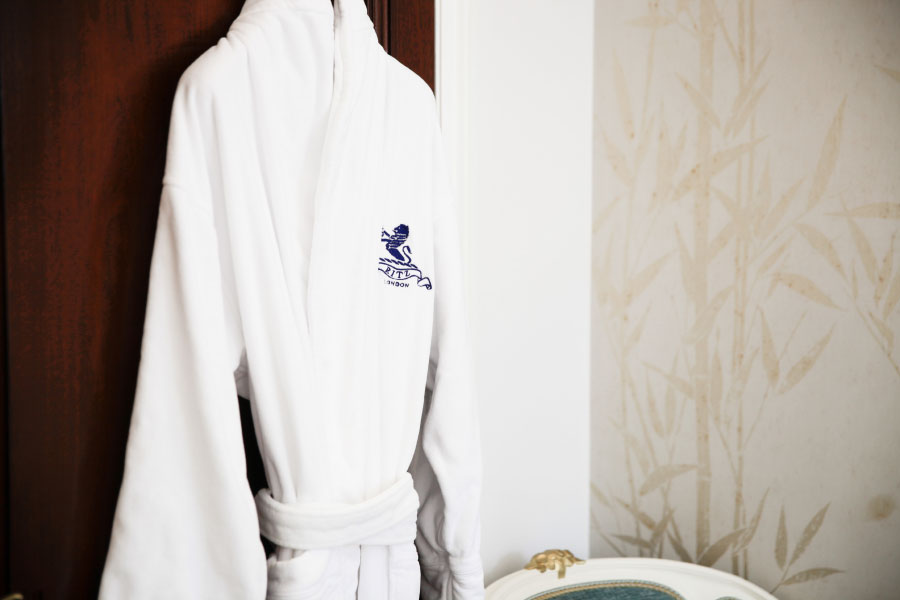 Luxurious bathrobe hanging at Hiro Miyoshi at The Ritz