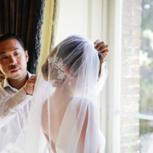 Hiro Miyoshi adding finishing touches to a bride